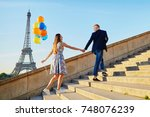 romantic couple with colorful... | Shutterstock . vector #748076239