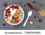 muesli breakfast fruits yogurt... | Shutterstock . vector #748094980