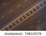 the road from top view in kedah ... | Shutterstock . vector #748119178