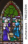 Small photo of LONDON, GREAT BRITAIN - SEPTEMBER 19, 2017: The parable of the Fig tree on the stained glass in St Mary Abbot's church on Kensington High Street.