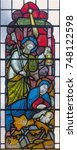 Small photo of LONDON, GREAT BRITAIN - SEPTEMBER 19, 2017: The Nativity on the stained glass in St Mary Abbot's church on Kensington High Street.