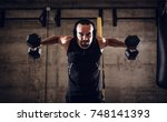 young muscular man doing hard...   Shutterstock . vector #748141393