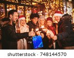 cheerful six young friends...   Shutterstock . vector #748144570