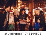 six smiling young friends...   Shutterstock . vector #748144573