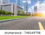 asphalt road through the modern ... | Shutterstock . vector #748169758