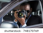 young african photographer with ... | Shutterstock . vector #748170769