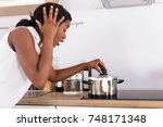 shocked african woman looking... | Shutterstock . vector #748171348
