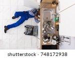 high angle view of handyman... | Shutterstock . vector #748172938
