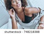 revealing her true self.... | Shutterstock . vector #748218388