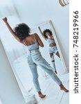 she is a superstar. full length ... | Shutterstock . vector #748219966