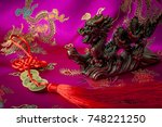 Small photo of Wealth and power symbolized by the fengshui coins charm and the asian mystic dragon. Feng Shui is a Chinese philosophical system of harmonizing everyone with the surrounding environment