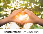female hands in the form of... | Shutterstock . vector #748221454