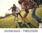 playful friends. group of young ... | Shutterstock . vector #748223200