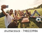 going crazy together. group of... | Shutterstock . vector #748223986