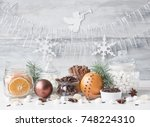 christmas spices and sweets on... | Shutterstock . vector #748224310