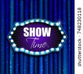 show time. retro light sign.... | Shutterstock . vector #748230118