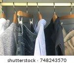 mens wardrobe clothing hanging...   Shutterstock . vector #748243570