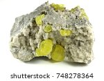 Small photo of native sulfur on aragonite from Sicily/ Italy isolated on white background