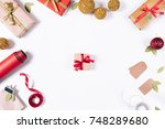small box with a gift and a red ... | Shutterstock . vector #748289680