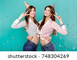 funny female twins in birthday... | Shutterstock . vector #748304269