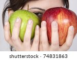 young beautiful woman holding two apples - green and red. - stock photo