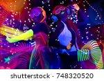 2 sexy cyber glow raver women... | Shutterstock . vector #748320520