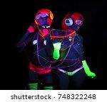 2 sexy cyber glow raver women...   Shutterstock . vector #748322248
