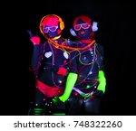 2 sexy cyber glow raver women...   Shutterstock . vector #748322260