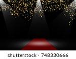 golden confetti on red carpet | Shutterstock . vector #748330666