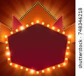 retro stage shining banner... | Shutterstock .eps vector #748346218