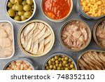 open tin cans with different... | Shutterstock . vector #748352110