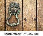 lion head door knocker  ancient ... | Shutterstock . vector #748352488