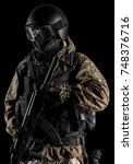 one soldier holding assault... | Shutterstock . vector #748376716