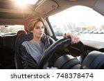 beautiful casual girl drive a... | Shutterstock . vector #748378474