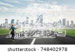 back view of engineer woman in...   Shutterstock . vector #748402978