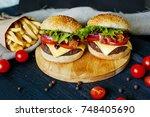 two beef burgers  fries... | Shutterstock . vector #748405690