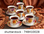 tea set on the background of... | Shutterstock . vector #748410028