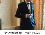 elegant handsome man in suit. | Shutterstock . vector #748444123