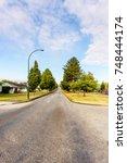 road in the suburbs | Shutterstock . vector #748444174