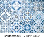 Small photo of Ceramic tile pattern elegant vintage and Tuscany flowers. Beautiful colored background for design and fashion with decorative Arabesque elements. Tuscany or Italian ornate floral decor for wallpaper.