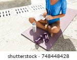 close up photo of woman body in ... | Shutterstock . vector #748448428