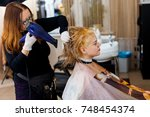 barber making hair coloring | Shutterstock . vector #748454374