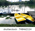 swan boats and yellow ships at... | Shutterstock . vector #748462114