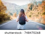 woman with road adventures with ... | Shutterstock . vector #748470268