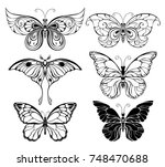 Stock vector set of artistically drawn outline black butterflies on white background 748470688