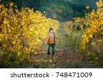 cute little boy in a yellow... | Shutterstock . vector #748471009
