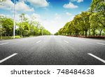 asphalt road and forest | Shutterstock . vector #748484638