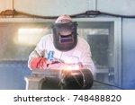 worker welding in steel pipe in ...   Shutterstock . vector #748488820