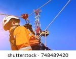 workers up high with safety... | Shutterstock . vector #748489420