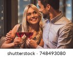 beautiful young couple is... | Shutterstock . vector #748493080